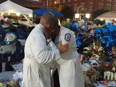 Trauma surgeons who tried to save the lives of the Dallas police officers went to the site to mourn.  Heart wrenching!!!!!!