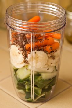 Collards, Banana, Honeydew, Carrots, Flaxseeds, Add Water & a Splash of Coconut Milk & Blend.