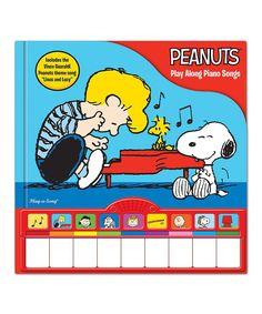 Take a look at this Peanuts Play Along Piano Songs Board Book today!