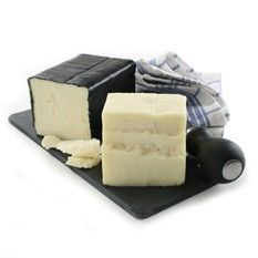 Chevre Noir is a Canadian made goat cheddar produced by Fromagerie Tournevent paird with a Cabernet. Queso Cheese, Wine Cheese, Goat Cheese, Canadian Cheese, Canadian Food, Cheddar, Cheese Gifts, French Cheese, Gourmet Cheese