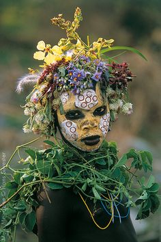 Painted faces, scarred bodies, wooden guns and extravagant headdresses: Amazing…