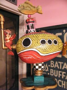 Funky Submarine..assemblage piece..old papier mache oversized Easter egg repainted, vintage newel post piece, plumbing pieces, propeller, wood cut and painted fish and repurposed mermaid