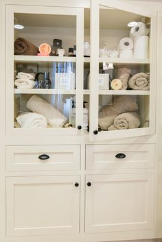 His and Hers Custom Linen Cabinet | by REDBUD Construction Services