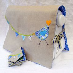 This sewing machine cover is so simple cute, and it helps get your investment clean of dust and lint.