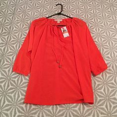 FINAL REDUCTION🌻 Giftable NWT Michael Kors Top Classic Blouse.  3/4 sleeves.  Tie top with Logo charms.  Color:Poppy MICHAEL Michael Kors Tops Blouses