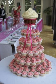 Giant cupcake wedding cupcake tower- would be great with a different flavor on each level.