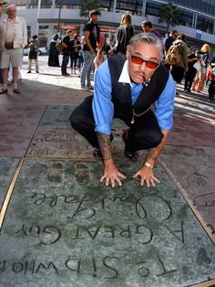 Billy poses outside the TCL Chinese Theatre in Los Angeles as he waits for the� Movie Monsters� auction to begin.