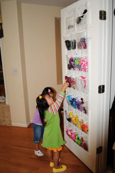 Clear-plastic, over-the-door shoe holder.  Perfect for baby Neli's hairbows and itty bitty shoes.