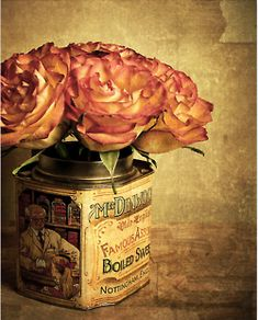 rustic vintage | shabby chic: beautiful variegated roses displayed in a tin with a vintage label. <3