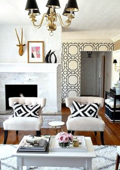 Black  White Living Room Decor // Ikea Pillows. Love everything but the gold deer head