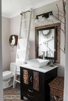 Turn a modern bathroom into one filled with farmhouse charm! Includes ladder towel holder, planked ceiling, vintage window moulding, etc. Written by Funky Junk Interiors for *Love the ladder towel rack Funky Junk Interiors, Estilo Interior, Plank Ceiling, Bathroom Inspiration, Bathroom Ideas, Bathroom Ladder, Small Bathroom, Bathroom Makeovers, Earthy Bathroom