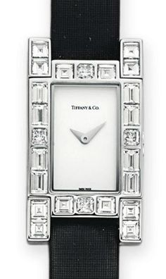 """A DIAMOND AND WHITE GOLD """"LUCIDA"""" WRISTWATCH, BY TIFFANY & CO.   With quartz movement, the rectangular dial and steeled hands, within a square and rectangular-cut diamond bezel, to the satin strap and rectangular-cut diamond clasp, mounted in 18k white gold, 8¼ ins., with Swiss assay marks and maker's marks  Signed Tiffany & Co., case no. 000760018"""