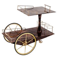 Liquor Trolley By Aldo Tura In Brown Parchment And Brass Details | From a unique collection of antique and modern bar carts at http://www.1stdibs.com/furniture/tables/bar-carts/