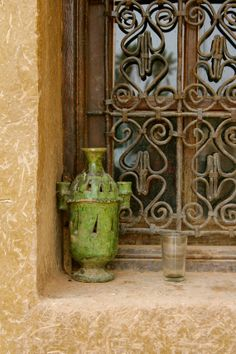 MOROCCAN WINDOW - ancient jade green pottery - ornamental window grate - mud wall - photo from Johanna Witter