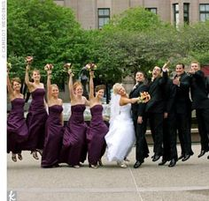 The six bridesmaids wore strapless, ruched satin embroidered ball gowns in plum from David's Bridal. The groomsmen wore black Tommy Hilfiger three-button suits with plum-color vests and ties, and the groom wore a similar ensemble with a white vest and tie...