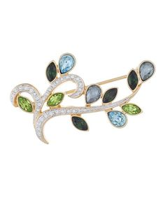 Crafted+of+gold-plated+pewter+and+sparkling+crystals+made+with+SWAROVSKI+ELEMENTS,+this+modern+pin+adds+a+touch+of+interest+to+any+ensemble.