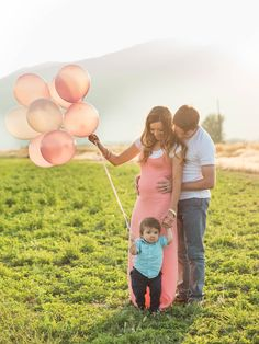 It's a girl baby announcement with pink balloons