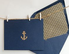 Nautical Anchor Stationery, Navy Blue with Gold Embossed Anchor and Hand Lined Envelope with Gold and Blue Japanese Paper. $6.00, via Etsy.