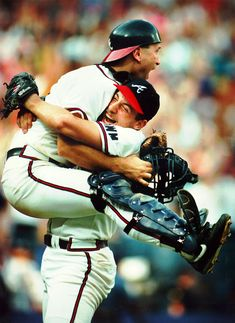Worst To First: Catcher Greg Olson jumps into the arms of winning pitcher John Smoltz after the Braves' 5-2 victory Oct. 5, 1991, over the Astros and clinched at least a tie for the National League West title. San Francisco later beat the Los Angeles Dodgers to give Atlanta sole possession of the NL West. (FRANK NIEMEIR / AJC File)