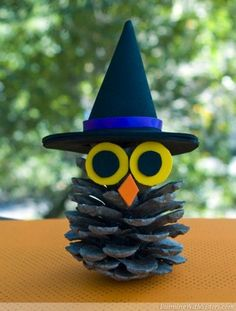 You'll be having a h-owl-ing good time this Halloween when you make this cute nature craft for kids. The Witchy Pinecone Owl is perfect to make to make as a home decor craft. You can place it on the mantle or use it as a centerpiece.