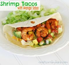 Shrimp Tacos with Mango Salsa. These yummy tacos make you feel like you are eating in a Mexican restaurant! #recipe #tacos #shrimp -from creationsbykara.com