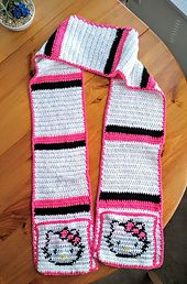 The pockets of this scarf are made separately (using tapestry crochet for the logo), then sewn on to a completed scarf.