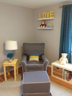 Nursery Glider and yellow table with lamp