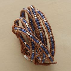 """five-wrap bracelet with button clasp: faceted sodalites and sterling silver nuggets tethered o brown leather borders. designed by Chan Luu. 32"""" to 34""""L."""