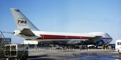 1969 - Parked at TWA's O'Hare hangar, the jumbo is prepared for its onward flight to JFK