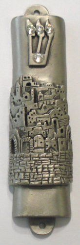 This Genuine Pewter Mezuzah is adorned with three genuine Austrian crystal stones in the shin. Comes with a Kosher scroll. Detailed depiction of the city of Jerusalem. The mezuzah case is approximatel