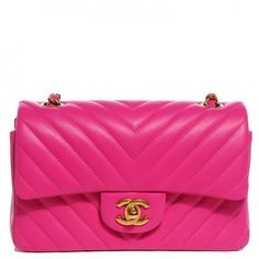 This is an authentic CHANEL Lambskin Chevron Quilted Rectangular Mini Flap in Fuchsia. The chic little cross body classic baguette is crafted of soft lambskin leather with a chevron quilting in bright pink.
