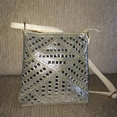 Sparkly studded pleather hand bag Brand new never used cream purse w/ gold accents & clear crystals , silver mini studs on a a shimmery gold cloth background . Long adjustable strap. Inside has zipper on one side & 2 pockets on the other w/ a middle zipper devider Bags Shoulder Bags