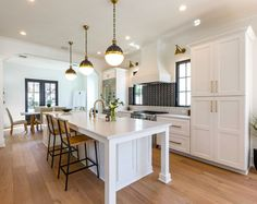 The kitchen island features simple square legs. The island dimension is 145″ x 44″. Home Bunch Blog
