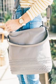 @caitlinclairexo sporting her Fossil favorites: the Q Modern Pursuit hybrid smartwatch and the Maya hobo handbag.