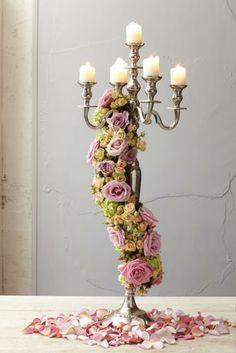 A romantic shabby chic display, using Memory Lane and Keano roses, Romantica Pepita spray roses, hydrangeas, hypercium berries and flat moss.