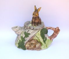For piping hot cups of tea....  Vintage Italian teapot with bunnies by invisiblecrown