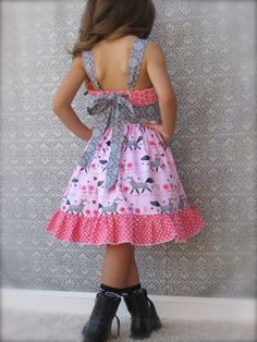 Stripwork Dress for Spring/Summer. Pink background with Gray fox on the skirt portion, an animal print in Salmon for the top