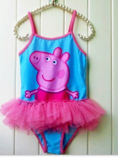 Beautiful Peppa Pig Swimsuit in Aqua with Pink Tutu Frills - $16.50  Please check the measurements provided below to ensure that you buy the correct size for your little fan.  Perfect for swimming or playing dress up!  Fabric: 90% Polyamide; 10% Elastane  Measurements: Chest around; length top of shoulder to bottom - in cm's  Size  2-3 (2A) 44; 44  3-4 (4A) 46;  47  4-5 (6A) 50; 49  5-6 (8A) 52; 51