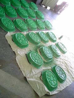 NINJA TURTLE SHELLS!! Spray paint turkey trays with green paint. For the girls I added glitter spray paint on top of the green! I poked holes to tie the elastic and kids wore them as backpacks!
