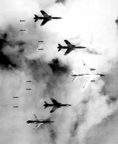 Flying under radar control with a B-66 Destroyer, Air Force F-105 Thunderchief pilots bomb a military target through low clouds over the southern panhandle of North Viet Nam. June 14, 1966