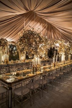 This extravagant setting (complete with mirrored tables and matching chairs) effortlessly complements the old-world aesthetic of the understated color palette and lavish decor. Brass candelabras and an overhead installation of plated sculptures lend the perfect finishing touches.