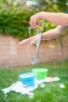 Supergirl's birthday party activity. Replace sand currently in our water table with bubble solution. Hand out straw/yarn frames.
