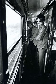 Mick Jagger and Brian Jones on a train, 1960s.