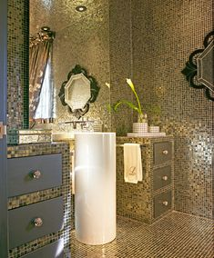 'Bling' powder room covered in pewter glass mosaic tile. Photo by Gene Meadows. Room Service Interior Design.