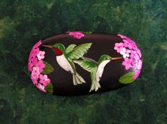 This is one of my latest creations. It is a gorgeous pair of Ruby Throated Hummingbirds flying amidst pink and purple flowers (verbena).