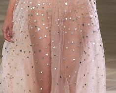 Pink netted dress with silver hearts. Runway.