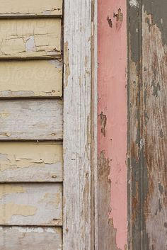 Close up of a chipped paint door and siding by goodnessgrace | Stocksy United #StocksyWAC #pink #thinkpink #pinkandyellow #colorcombo