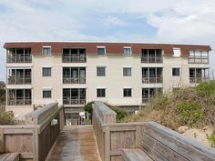 Come to Nags Head and vacation at OCEANVIEW condo.  OCEANVIEW is a wonderful second floor unit in Admirals View overlooking the community pool and boasts fantastic beach and ocean views. Relax on your private covered balcony and watch the magnificent sunrises over the ocean. With an elevator, pool and private beach access, this place has it all, including free wireless Internet, ocean views from the living area, master bedroom and balcony. Be sure to reserve OCEANVIEW for your vacation soon.
