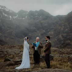 Ceremony shot with celebrant, full length positioned at bottom of frame with scenery behind