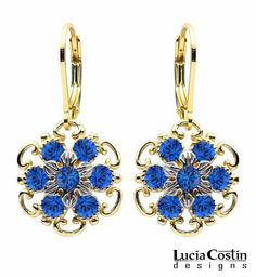 Lucia Costin Flower Shaped Dangle Earrings Made of 24K Yellow Gold Plated over .925 Sterling Silver with Sterling Silver 6 Petal Flowers and Twisted Lines, Crafted with Dots and Blue Swarovski Crystals Lucia Costin. $48.00. Update your everyday style with inspiration when wearing this piece of jewelry. Unique jewelry handmade in USA. A perfect addition to your jewelry box. Enriched with deep blue Swarovski crystals. Lucia Costin flower shaped drop earrings
